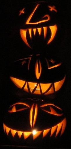 Three jack-o'-lanterns illuminated from within...